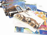 A stack of colorful postcards